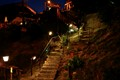 iluminated stairway to a restaurant in a mountain village in Tuscany