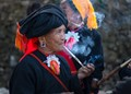 """Taken in the """"last tribe"""" in China, a remote village in Yunnan, China in 2015. The women there smoke to while away the time. I was almost kneeling on the ground when I took the shot."""