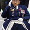 Remembrance Day 2019: 99-year-old Paul DeLorme, a Metis man who served with the South XXX Regiment in the Second World War, who came to lay a long-stemmed white rose at the cenotaph to honour his fallen comrades. Mr. Delorme salutes the crowd applauding him as he exits the Remembrance Day ceremonies in downtown XXX  Mr.DeLorme  was wounded in the 1942 Dieppe Raid and kept as a prisoner of war for three years