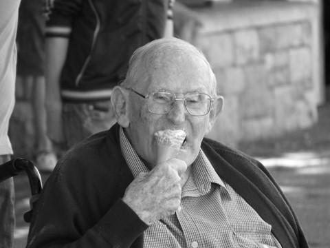 Old man enjoys a treat