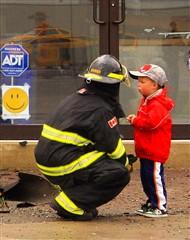 fireman comforts young boy