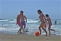 playing football at beach