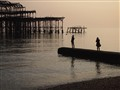 Sunset on Brighton beach by the old pier