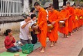 Monks receiving rice in Luang Prabang, Laos