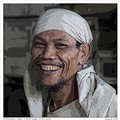 Indonesian sugar worker happy in his work