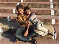 Friends. On stairs of Jama Masjid. New Delhi. India.