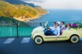 Wedding party in a Fiat Jolly in Ravello, Italy.