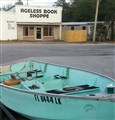 Old boat across street from Ageless Book Shoppe setting.