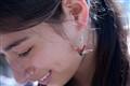 Japanese girl wearing origami earring
