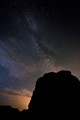 A landmark rock for climbers and a foreground silhouette for the Milky Way.