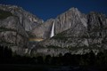 Nighttime photo of Yosemite Falls with moonbow - rainbow created by moonlight.