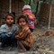 vulnerable childhood: Small kids playing around dust and dirt in Terai, Nepal