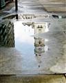 puddle reflecting city hall