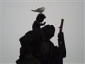man, child and bird