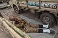 forgetting his task,laying way side,Red Road ,Kolkata,India.