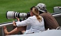 Female photographer at a Cricket match