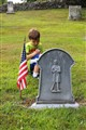 boy next to the solider grave