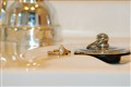 Sacred Wedding rings on sink...