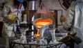 Team pours molten bronze for sculpture