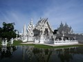"Wat Rong Khun, better known as ""the White Temple"" is one of the most recognizable temples in Thailand. The temple is just outside the town of Chiang Rai in the north east of the country."