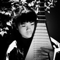 Chinese Girl Playing a Pipa