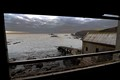 The coastal approaches viewed from the old abandoned Lizard lifeboat station at Polpeor Cove.
