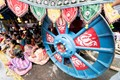Legend has it that devout Indian pilgrims wanted to be crushed by the great Iron wheel of Lord Juggernaut's Chariot on the Car Festival day,to reach heaven.Presently,they like so but to take shelter against rains.