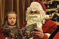 Santa reading, ol' style.