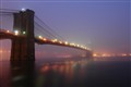 ...heavy fog at brooklyn bridge...