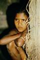 Bangladeshi girl, staring at foreign visitors, pondering her future