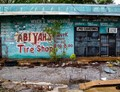 The user agreement is written all over the front of Abiyah's Tire Shop in Memphis, Tennessee.