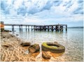 Rustic Old Wooden Jetty with Flotsam in foreground