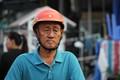 Vietnamese man headed to his day job