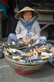 Old woman selling hand made knifes in Hué / Vietnam