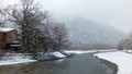 Snowing over a Scenic River