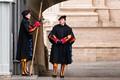 Swiss Guards chat outside the Vatican, Rome.