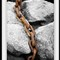 Rusted Chain Over Stone