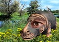 A terracotta hippo with my own eye and two other animals inserted in a river landscape.  A picture for my grandchildren