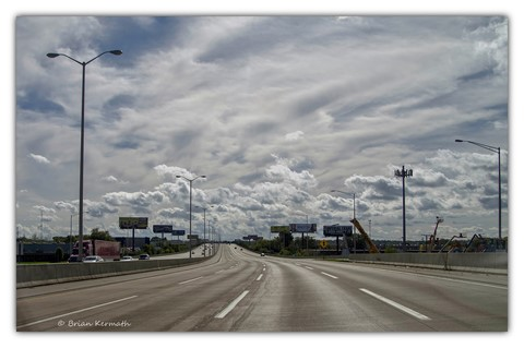 On the road again: billboards and clouds