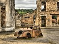 It was on 10th of May 1944 when the first regiment of the 2nd SS-Panzer-Division Das Reich as retaliation destroyed the village of d'Oradour sur Glane. 642 people were killed, The men were shot next to this village square and the women and children were blown up in the Church. The Church miraculously survived this blast. Only 6 people survived this massacre. After the war President de Gaulle declared that the city never will be re-built and serve as a national monument.
