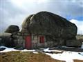 a shack on the rocks