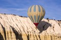 One of the many hot air balloons flying around in Cappadocia, this one precariously close to the rock wall.