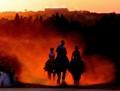 Riders at dusk