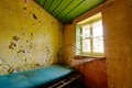 Vividly colored abandoned bedroom