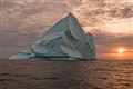 Iceberg With Orange Sun Setting