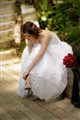 Candid of bride fixing shoe