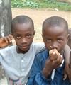Boys with wooden mobile phones, Monrovia, Liberai