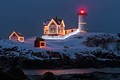 Nubble Lighthouse New Years Eve morning with a fresh coating of snow York Maine