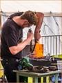 The blacksmith - burning carbon to work iron