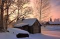 Frosty daybreak near the old barn